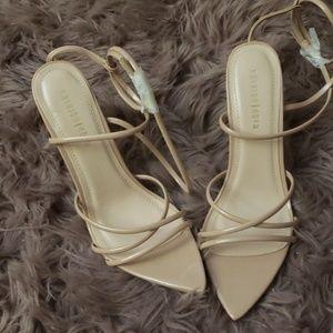 Nude pointed toe heels